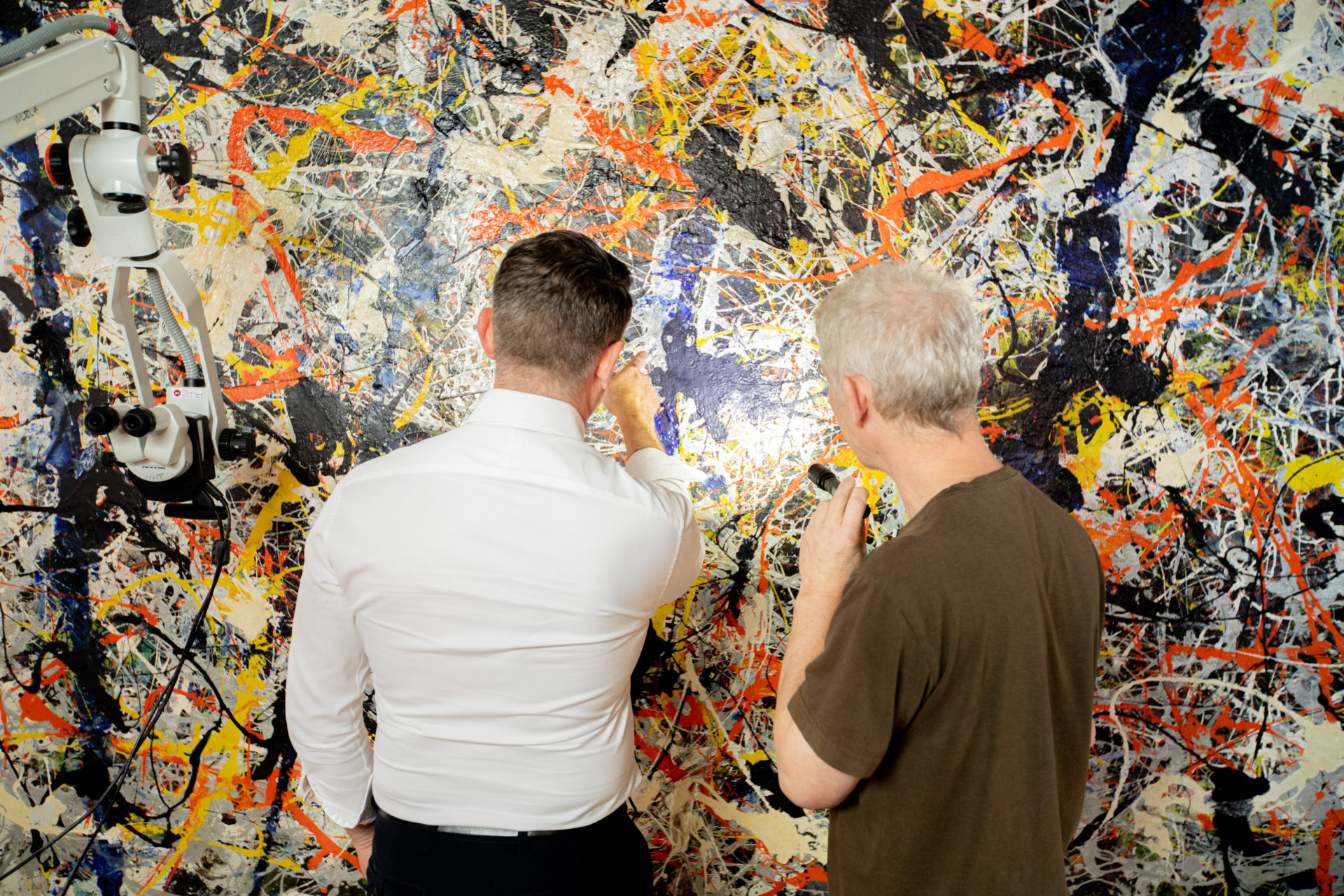 Senior Painting Conservator David Wise and National Gallery Director Nick Mitzevich inspect the painting